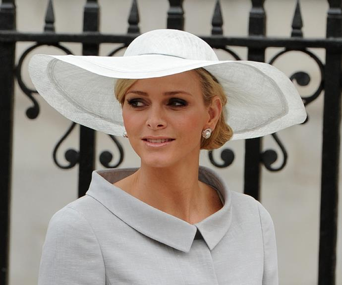 **Princess Charlene's** wide brimmed hat was as elegant a choice as any.