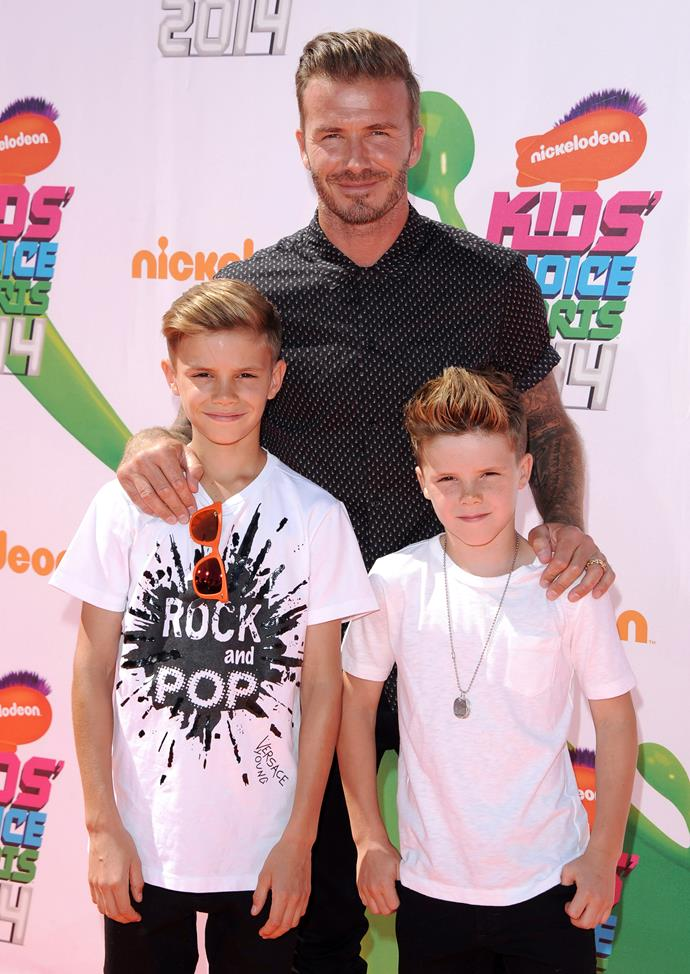 LOS ANGELES, CA - JULY 17: Former soccer player David Beckham, Romeo James Beckham (L) and Cruz David Beckham attend Nickelodeon Kids' Choice Sports Awards 2014 at Pauley Pavilion on July 17, 2014 in Los Angeles, California. (Photo by Allen Berezovsky/WireImage)
