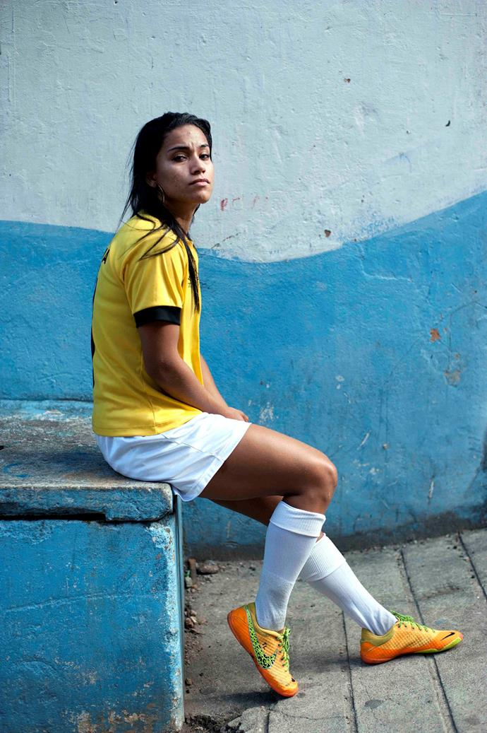 Aline França, 24, waits after her women's football tournament was canceled in the Borel favela in Rio de Janeiro. She says she lives for football but feels she was born in the wrong country, because opportunities for women in soccer are more abundant abroad. But she does whatever she can to continue playing the game - including doing military service in the past to play with the Armed Forces women's team, and currently balancing work, school and football. **Picture by Isabella Melody Moore via [itswhatartis](http://itswhatartis.com/)**
