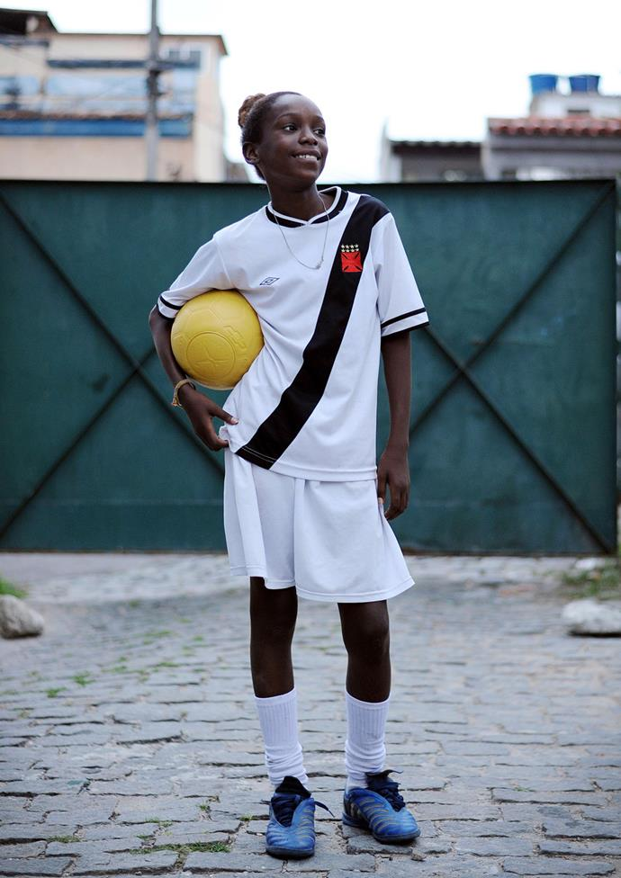 """Rebecca Cristiny, 12, at football practice in Complexo da Penha favela in Rio de Janeiro. Rebecca is on the women's team that took home the championship at the """"Street Child's World Cup"""" held in Rio earlier this year. She said winning was one of the best moments of her life. It was so emotional, that she felt as if she had won the World Cup. **Picture by Isabella Melody Moore via [itswhatartis](http://itswhatartis.com/)**"""