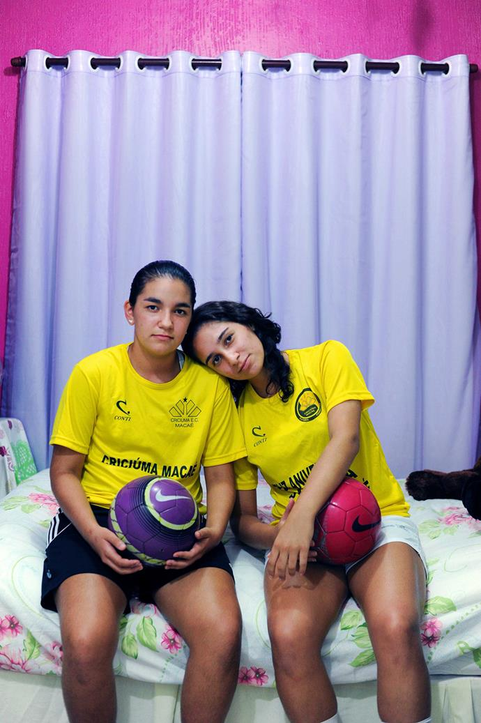 Joyce Rocha, 15, (left) and Juliana, 18, (right) in their bedroom in Recreio in Rio de Janeiro. For the two sisters football is an every day battle, but, because of this fight, women's football in Brazil has more heart. Their mother admits that most parents wouldn't support their two daughters playing football but from an early age, her daughters only played with footballs, as oppose to dolls. **Picture by Isabella Melody Moore via [itswhatartis](http://itswhatartis.com/)**