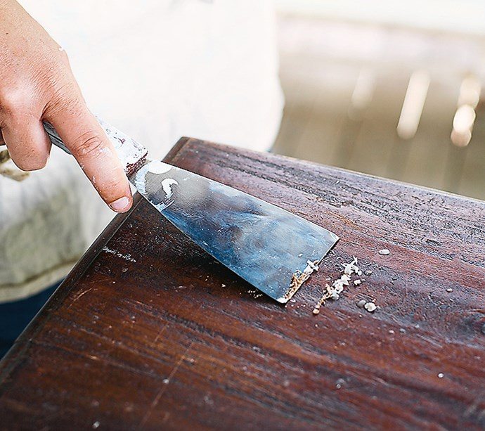 **STEP 2** Scrape back all of the old flaky paint, dirt and grime with a paint scraper – brush off the dust and clean your table with soap and water.