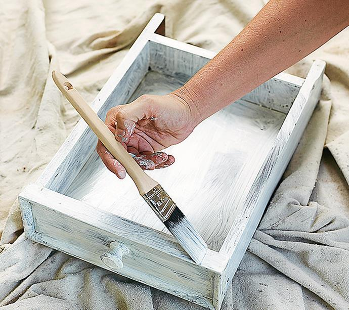 **STEP 4** Turn your table upside-down – then apply the primer under the table, the legs and inside/outside the drawers. Once dry, turn the table upright and paint the top and sides. Let it dry thoroughly.