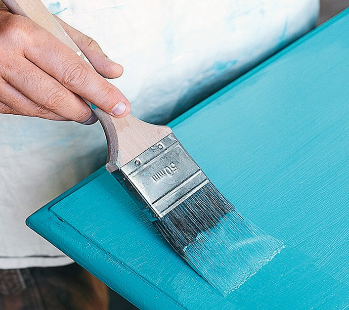 **STEP 5** Apply your first coat of colour to your difficult-to-get-to corners using your angled brush. Insert your brush about 2cm into the paint, tap on the side of the can to prevent dripping. Use your wider flat brush in long smooth strokes to the top, legs and sides.