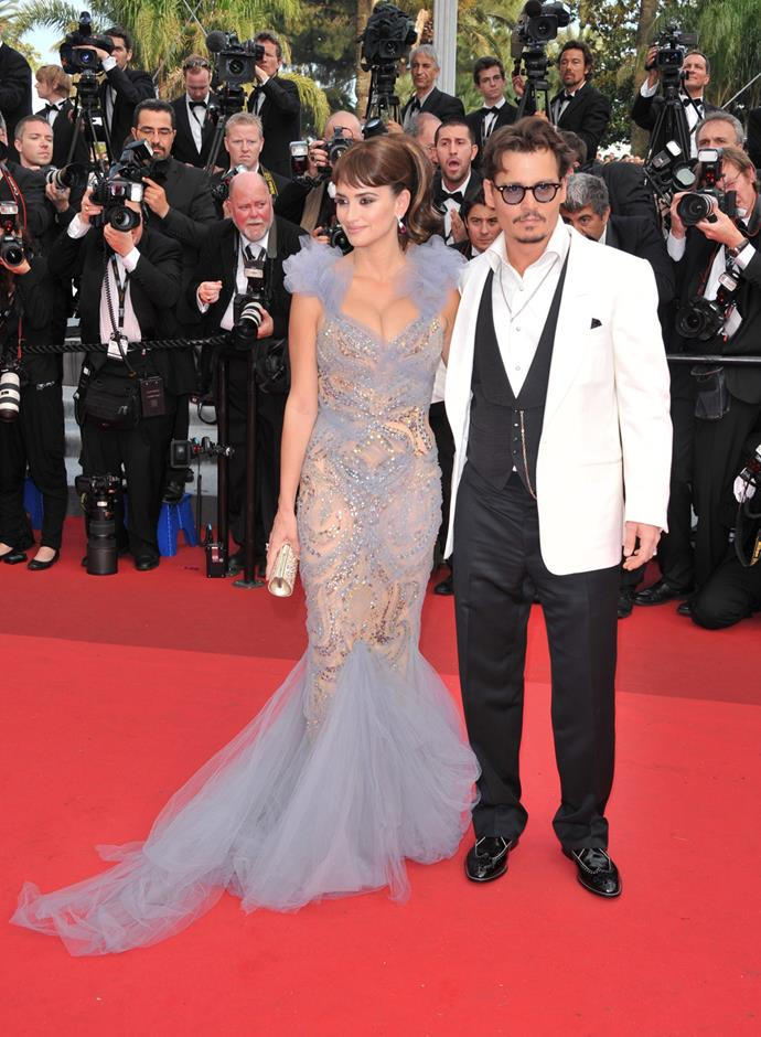 Penelope Cruz and Johnny Depp attend the *Pirates of the Caribbean: On Stranger Tides* premiere during the 64th Annual Cannes Film Festival at Palais des Festivals in 2011.