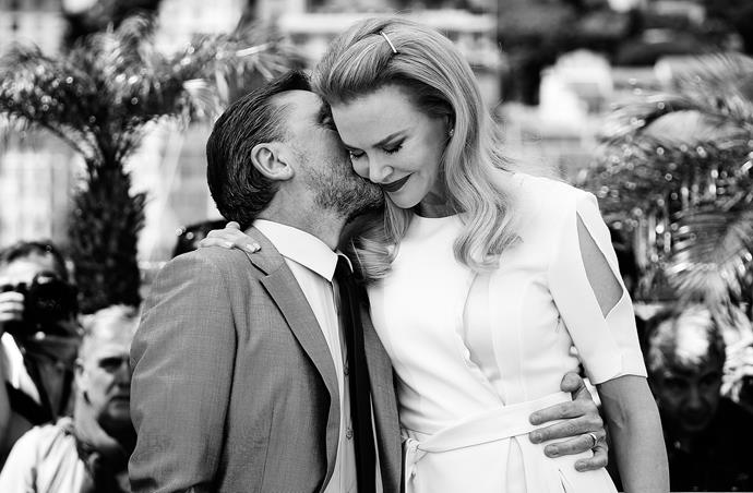 British actor Tim Roth gives Nicole Kidman a kiss during a photocall for the film *Grace of Monaco* at the 67th Cannes Film Festival, 2014.
