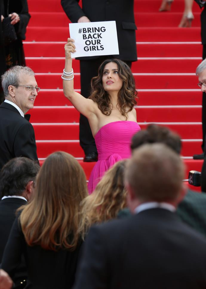Actress Salma Hayek attends the 'The Prophet' premiere during the 67th Annual Cannes Film Festival in 2014 and flashes a #bringbackourgirls sign to mark the kidnapping of 276 schoolgirls kidnapped from Government Secondary School in Chibok, Nigeria.