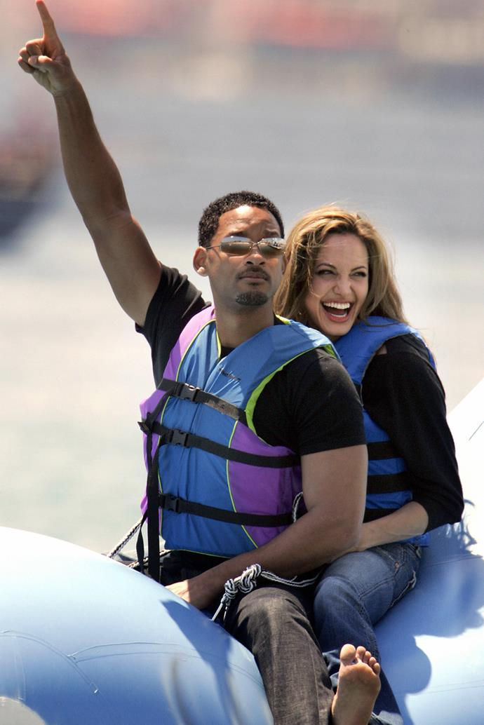 Will Smith and Angelina Jolie ride into shore at the Carlton Hotel beach on a promo float for their film *Shark Tale*, at the 57th Cannes Film Festival in the French Riveria town in 2004.