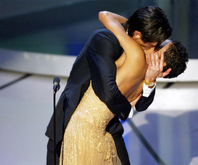 **The kiss** When dark horse, Adrien Brody's name was called out in the Best Actor category, no one was as stunned as he. Daniel Day Lewis was thought to be the front runner for *Gangs of New York*. Adrien strode onto the stage, he pulled presented Halle Berry in by the waist and gave her a kiss that has gone down in history.