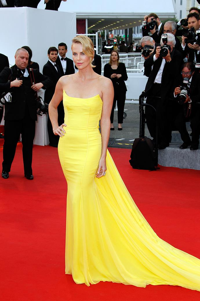 Looking every inch the movie star she is, Charlize Theron glowed in her bright yellow Christian Dior.