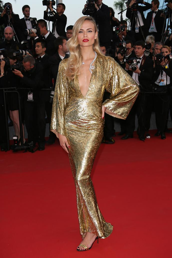 In her second red carpet appearance, Natasha Poly didn't appear to be slowing down. Her gold Michael Kors gown, with snake necklace screamed 'old school glamour'.