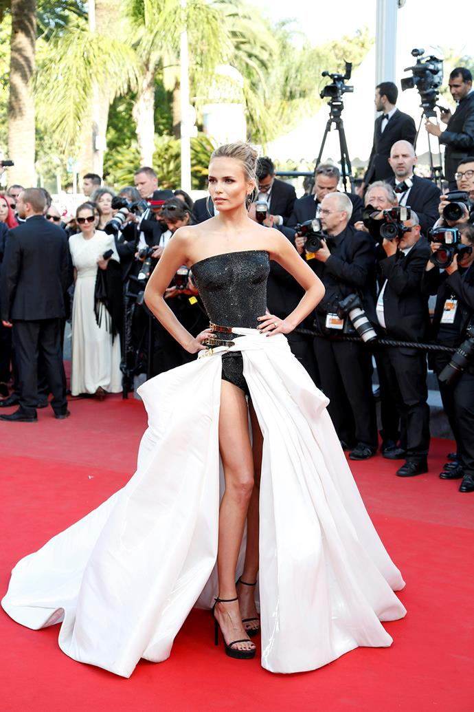 """Not afraid to put her best foot forward - or her entire leg - model Natasha Poly certainly stood out in her Atelier Versace ... """"gown""""?"""