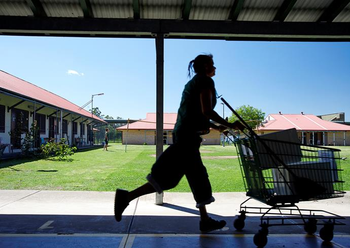 An inmate runs by with a trolley Emu Plains Correctional Centre. PHOTO: Nick Cubbin.