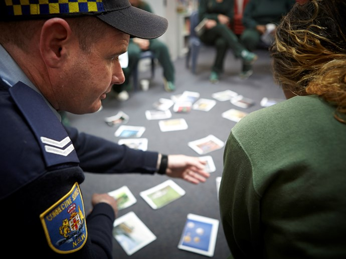 A correctional officer has a quiet word to an inmate undergoing a new drug and alcohol rehabilitation program at Dillwynia Correctional Centre. PHOTO: Nick Cubbin.