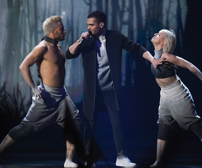 **9th place:** Flanked by two strapping and enthusiastic contemporary dancers, Azerbaijan's Elnur Huseynov performed his hit *Hour of the Wolf*, to a cheering crowd. A few earsplitting high notes and weird dance moves probably kept him back from a high spot.