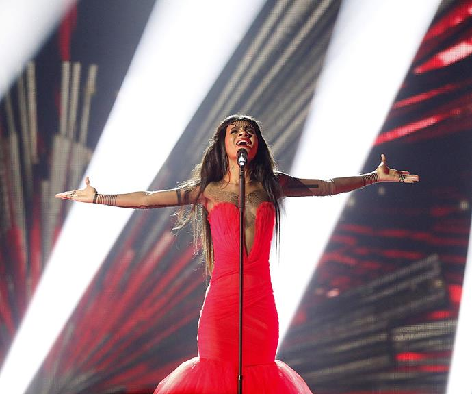 **8th place: Latvia** Wearing an impressively puffy red gown and some interesting headwear, Latvia's Aminata belted out a techno-influenced *Love Injected*. Highlights: her standstill dance moves and catchy tune.