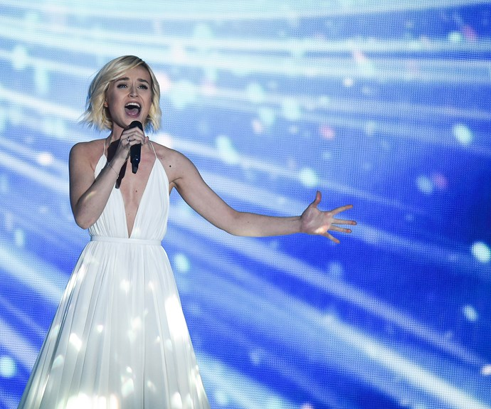 **2nd place: Russia** You know when you can just tell from a picture that someone is singing a power ballad? Yep, us too. Was Polina Gagarina of Russia's *A Million Voices* actually Vladimir Putin trying to do some PR damage control? We don't know. Was Polina's dress a knock out? Sure was. Her singing wasn't all that bad, either.