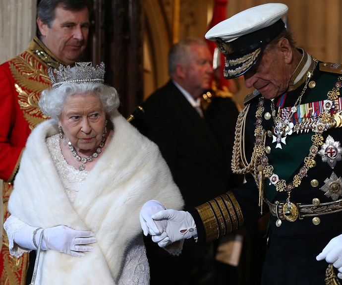 Holding her hand, Prince Philip gently guided his wife, Queen Elizabeth, into the House of Lords.