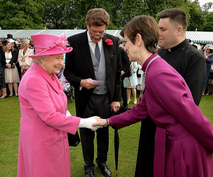After her big day yesterday, the Queen shelved the royal jewels and ermine furs for a pink coat and hat.