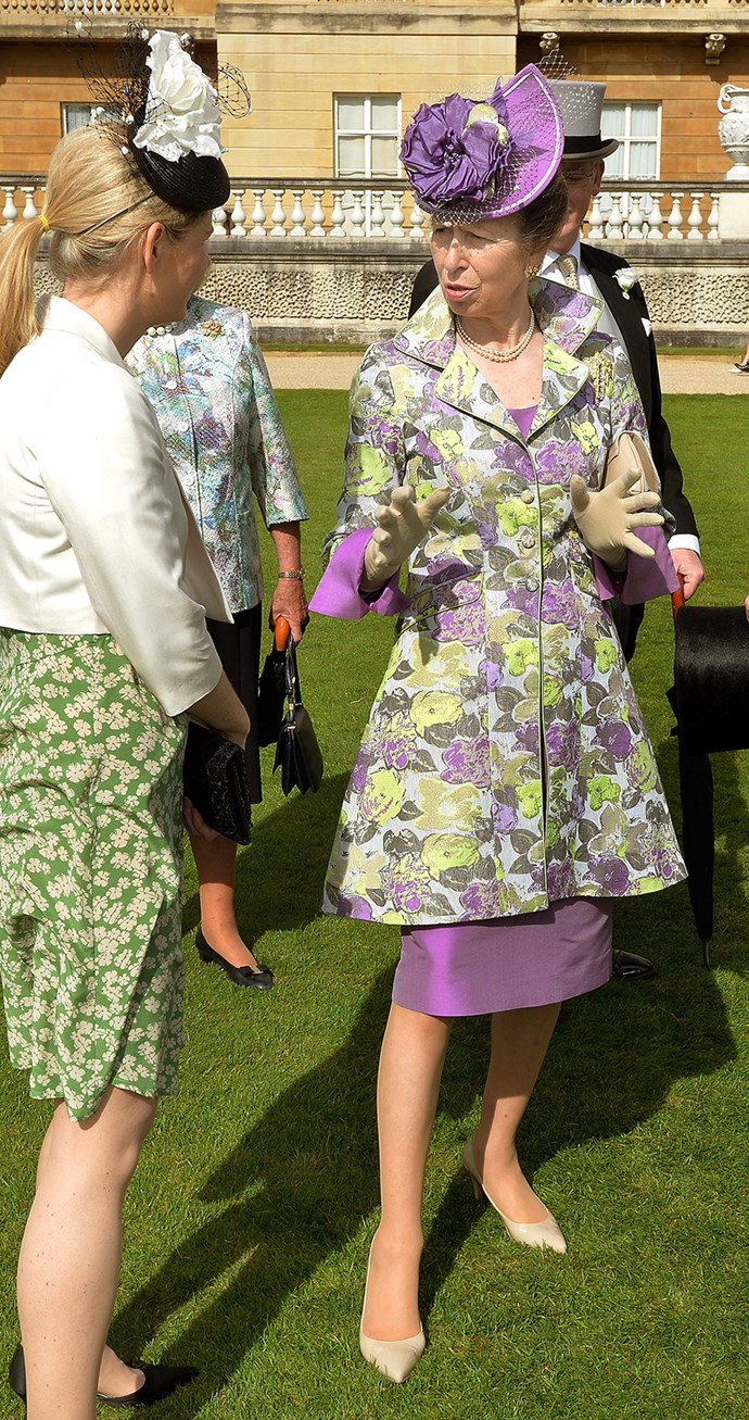Wearing a purple and green ensemble, the Princess chatted to guests.