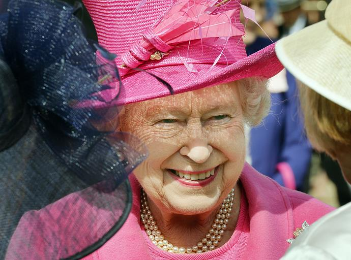 Cracking a smile at a royal garden party.