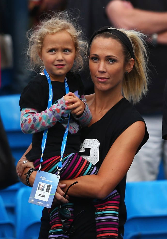 Bec Hewitt (R) and daughter Ava watch Lleyton Hewitt of Australia in his men's singles first round match against Kevin Anderson of South Africa during day one of the Aegon Championships at Queen's Club on June 15, 2015 in London, England. (Photo by Clive Brunskill/Getty Images)