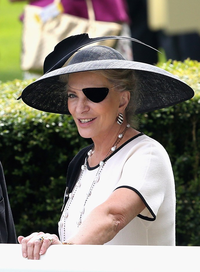 Princess Michael of Kent was seen wearing a black and white outfit, including a large feathered hat and a post-surgery black velvet eye-patch, in 2016.