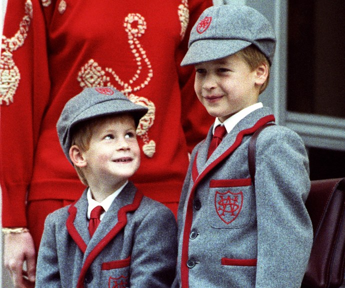Harry looks adoringly at his older brother on his first day of school in 1989.