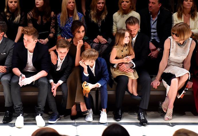The Beckham clan sitting next to fashion royalty Anna Wintour.