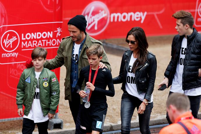 Romeo Beckham receives the support of his family, brother Cruz Beckham, father David, mum Victoria and brother Brooklyn Beckham after taking part in the junior marathon in London.