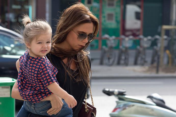 Cute. Victoria carries Harper on her hip in Paris.