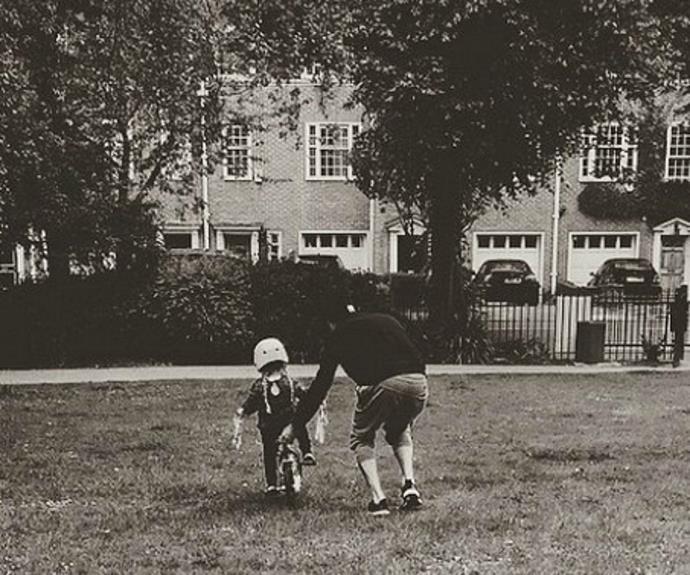 David teaching Harper how to ride a bike.