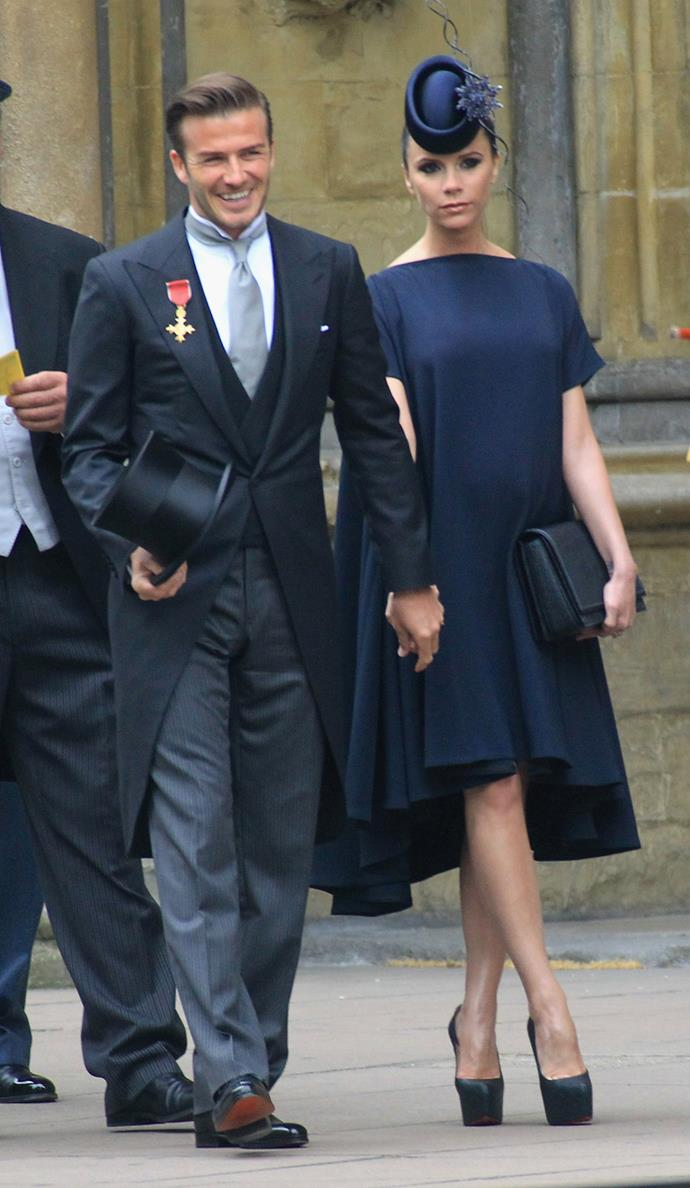 David and a very pregnant Victoria Beckham arriving at the wedding of the Duke and Duchess of Cambridge in 2011.