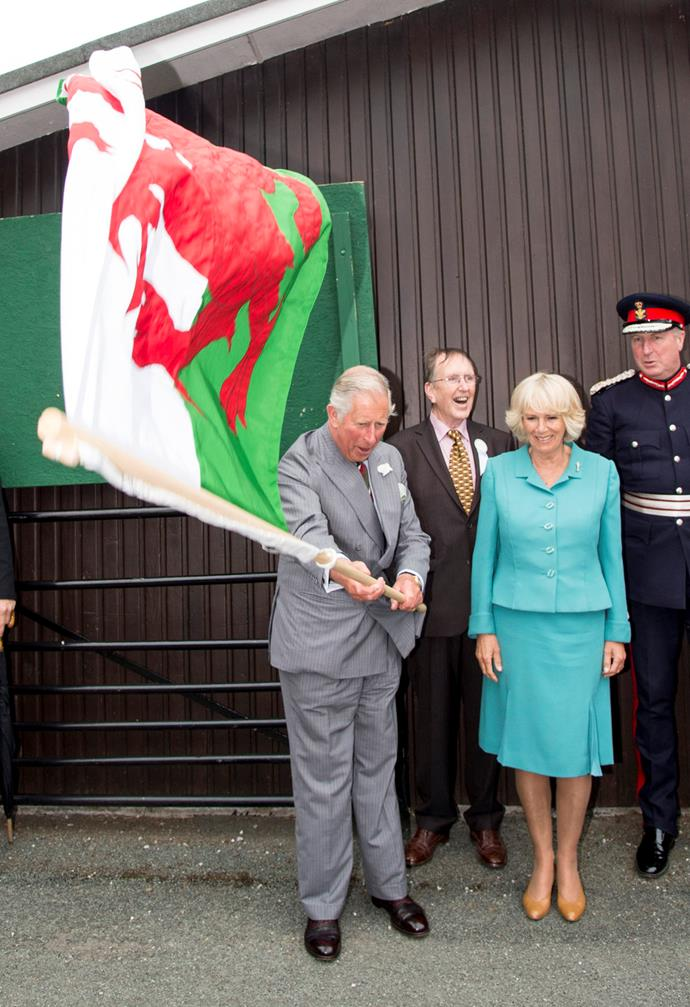 And wave the local flag with wife Camilla by his side.