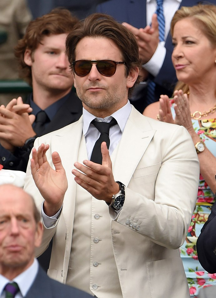 Looking sharp in a cream three-piece suit, Bradley Cooper attended with friends.