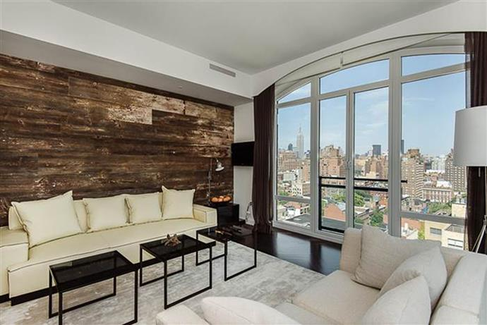 The home – which comes furnished – has hardwood floors, floor-to-ceiling windows to illuminate the views of the Empire State Building, Freedom Tower and the Hudson River.