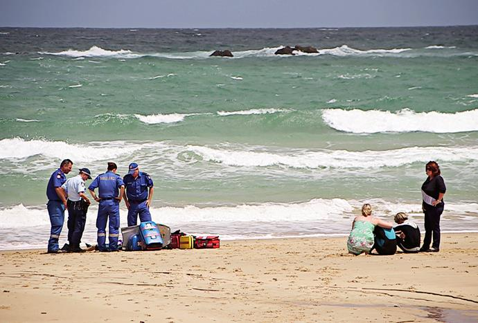 The boys are comforted on the sand after helping Zac to the shore and commencing CPR.