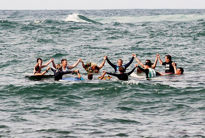 Zac's friends took to the water to give him a surfer's farewell.