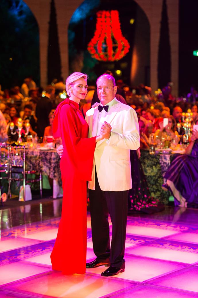 Prince Albert's simple white dinner jacket and black trousers complemented Charlene's bold look perfectly.