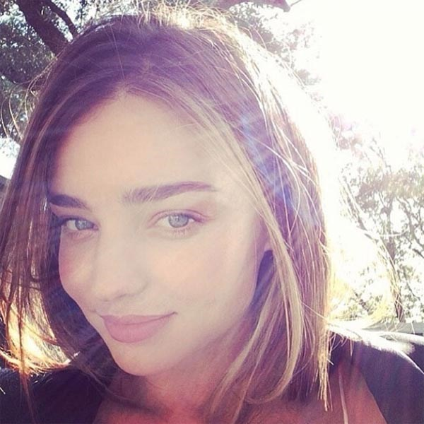 Golden girl Miranda Kerr redefines the term *au natural* with this barely-there, at-one-with-nature look.