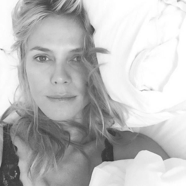 Heidi Klum's floating on a make-up-free Cloud 9 in this in-bed selfie.