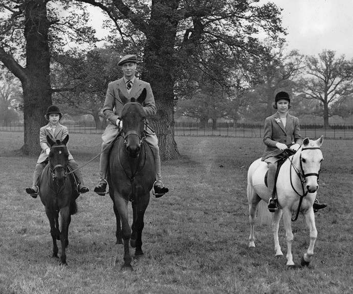Queen Elizabeth, then Princess Elizabeth, with her father, King George and sister, Princess Margaret, riding on their estate, Windsor Great Park.