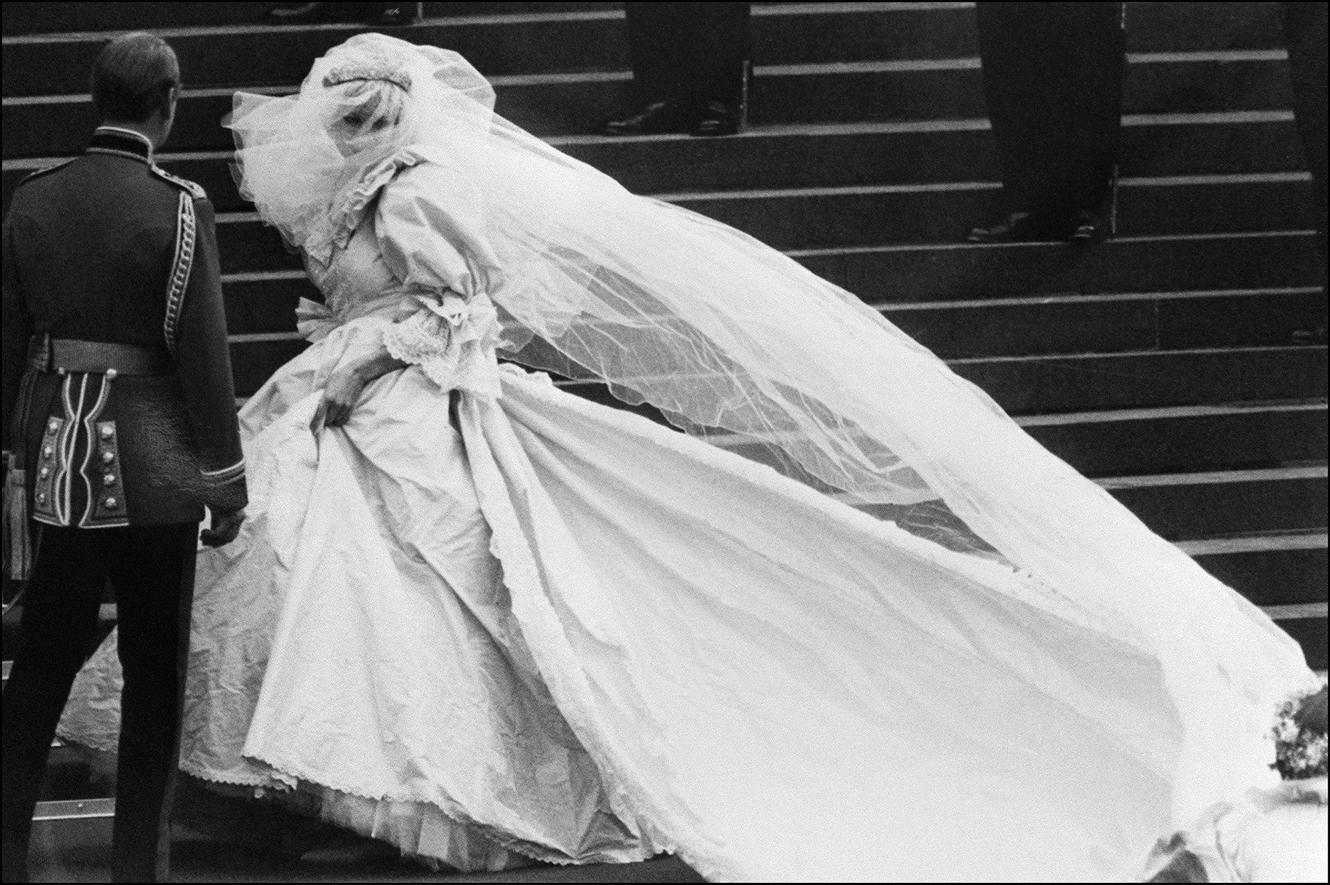 Diana Spencer's silk tafetta gown embodied the 80s: big, puffy with bows, pearls and embroidery - oh, and a 25-foot train. Diana wore her family's heirloom tiara, the Spencer Tiara.