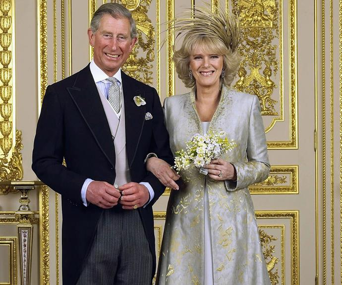 For his second marriage, Prince Charles' wife, Camilla, chose this pale blue and gold embroidered coat-gown with a feathered headpiece.