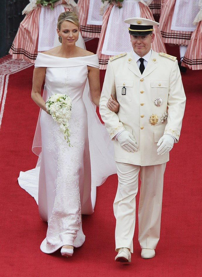 Charlene Wittstock married Prince Albert of Monaco in a Giorgio Armani silk gown with a boat neck collar. She did not wear any headpieces at all.