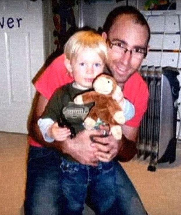 Here little Ollie can be seen with his late father, Greg.