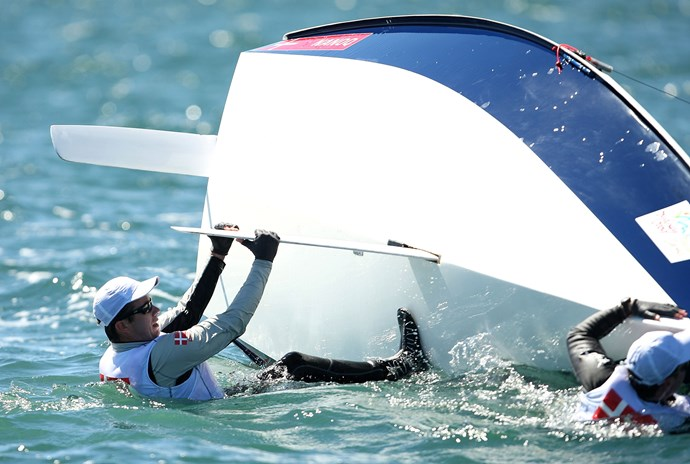Oh no! Prince overboard! Prince Frederik attempts to right his boat after capsizing in the 2009 Sydney World Masters Games.