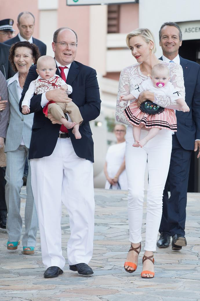 Albert and Charlene wore matching white and red outfits.