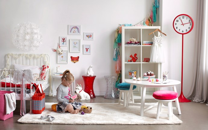 **White Foundations.** By keeping all the furniture pieces in a children's room white, you can keep the room simple and clean – add pops of colour through decorative elements such as clocks and artwork.  *Image / Will Horner*