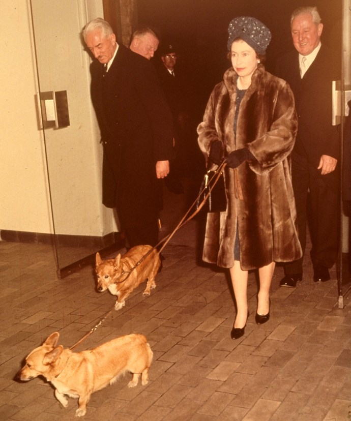 Queen Elizabeth and two corgis at Liverpool Street Station